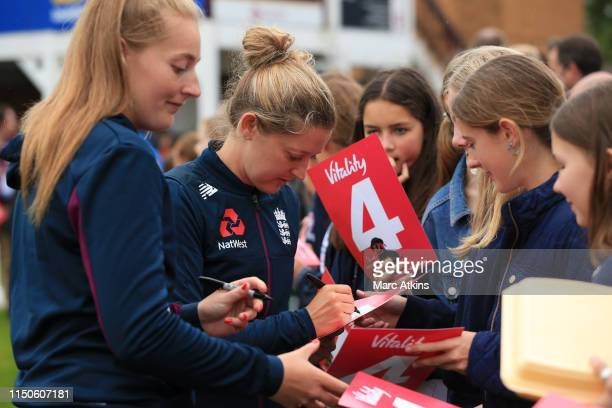 England players sign autographs for fans as the coin toss is delayed prior to the 1st Vitality Women's IT20 between England and West Indies at The...