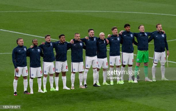 England players sing the national anthem before the UEFA Euro 2020 Championship Group D match between England and Scotland at Wembley Stadium on June...