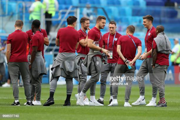 England players speak during a pitch inspection prior to the 2018 FIFA World Cup Russia 3rd Place Playoff match between Belgium and England at Saint...