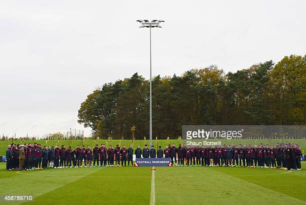 England players, staff and members of the Armed Forces observe an Armistice Day silence during an England training session, ahead of the UEFA...