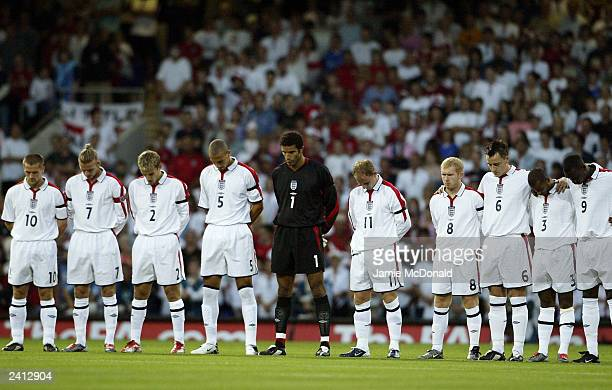 England players stand for a minute silence in memory of Jimmy Davis during the International friendly match between England and Croatia at Portman...
