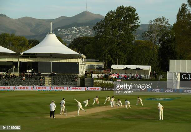 England players surround the bat as Dawid Malan bowls to Neil Wagner towards the close of play during day five of the Second Test Match between the...