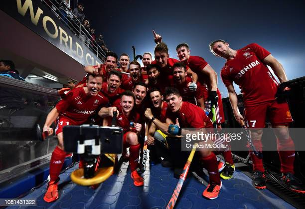 England players take a selfie photograph as they celebrate victory after the FIH Men's Hockey World Cup quarter final match between Argentina and...