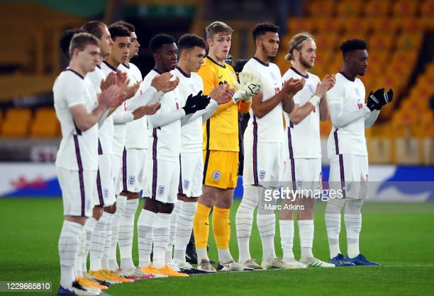 England players take part in a minutes applause for the late Ray Clemence during the UEFA Euro Under 21 Qualifier match between England U21 and...