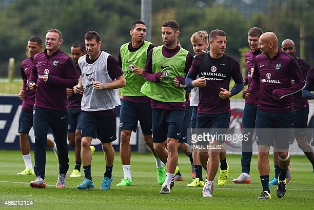 England players take part in a team training session at St George's Park BurtonuponTrent central England on September 2 ahead of their UEFA Euro 2016...