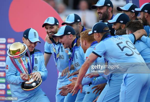 England players wait excitedly for their captain Eoin Morgan to lift the World Cup Trophy at the end of the Final of the ICC Cricket World Cup 2019...