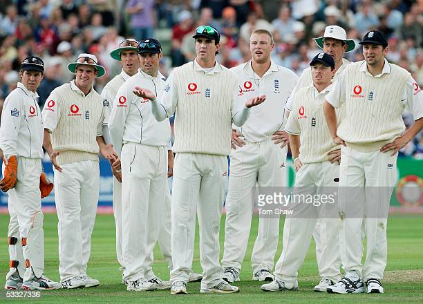 England players wait for Damien Martyn's run out decision during day two of the Second npower Ashes Test match between England and Australia at...