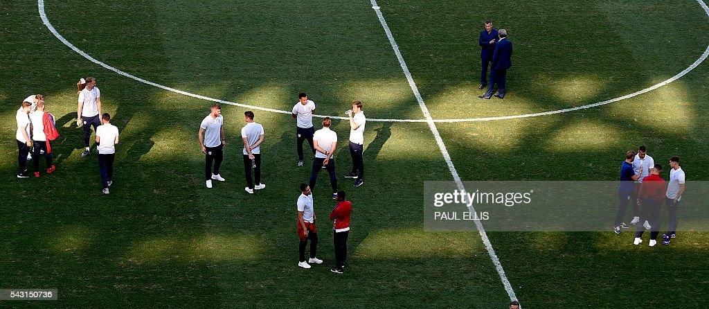 England players walk around in the stadium in Nice, on June 26, 2016 during the Euro 2016 football tournament. / AFP / PAUL