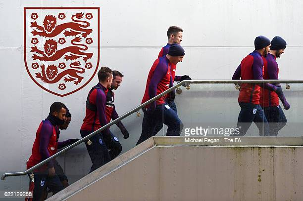 England players walk out for a training session ahead of the FIFA 2018 World Cup qualifying group F match against Scotland at St George's Park on...
