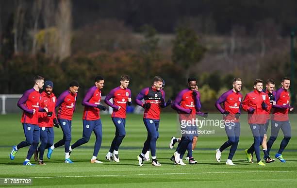 England players warm up during a training session prior to the International Friendly match against the Netherlands at the Tottenham Hotspur training...