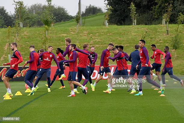 England players warmup during a training session at St George's Park near BurtonUponTrent in central England on September 3 2016 ahead of their World...