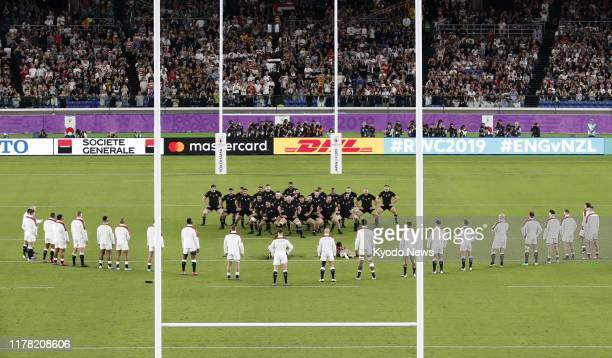 England players watch the New Zealand squad performing the haka prior to a Rugby World Cup semifinal on Oct 26 in Yokohama near Tokyo