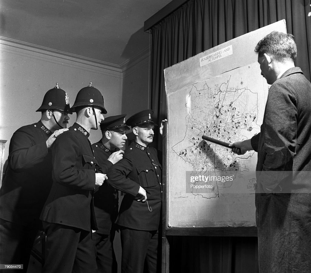 England, 1949, Policemen at the Leicester City Police headquarters are shown a map illustrating crime data
