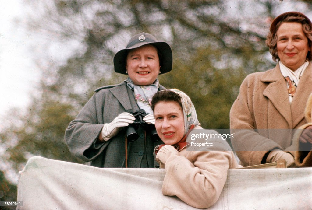 England. 1957. Queen Elizabeth II (front) and the Queen Mother are pictured at the Badminton Horse Trials. : News Photo