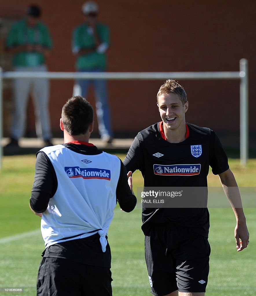 England replacement defender Michael Dawson (R) is welcomed by John Terry during a training session at the Royal Bafokeng Sports Campus near Rustenburg on June 5, 2010. Dawson was flown from England to replace captain Rio Ferdinand after he injured his knee during the team's first training session in the country on June 4.