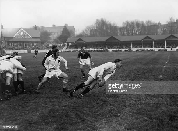 England Richmond and Cambridge rugby player P H Ryan pursues Northampton player Dickie Jeeps who is in possession of the ball during the England...
