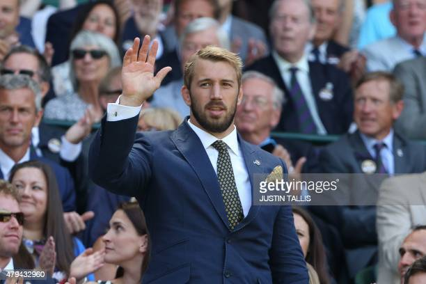 England rugby captain Chris Robshaw stands and waves in the royal box on centre court before the start of the men's singles third round match between...