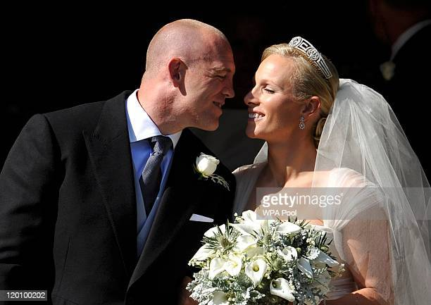 England rugby captain Mike Tindall and Zara Phillips kiss as they leave the church after their marriage at Canongate Kirk on July 30, 2011 in...