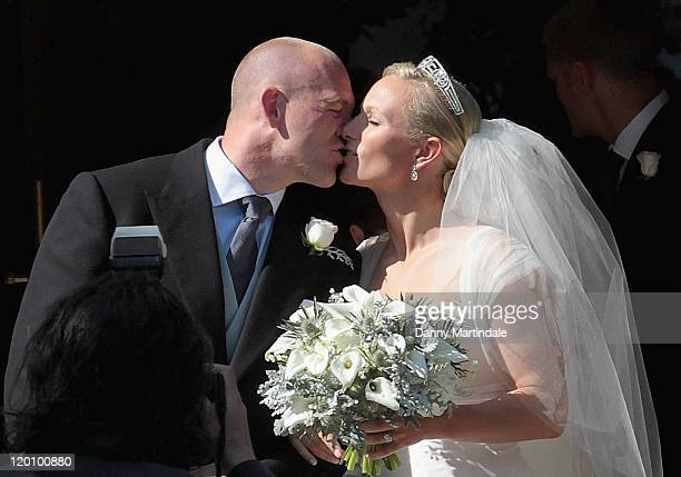 England rugby captain Mike Tindall and Zara Phillips kiss as they leave the church after their marriage at Canongate Kirk on July 30 2011 in...