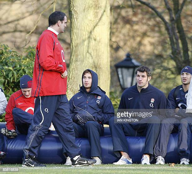 England rugby Coach Martin Johnson walks past Danny Cipriani Simon Shaw and Riki Flutey during a training session at Penny Hill Park in Bagshot...