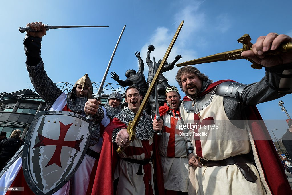England rugby fans (left to right) Alan Rosten, Simon Smith, Colin Clark, Will Littleboy and Neil Carter arrive at Twickenham stadium dressed as English Knights under the 'Core Values' sculpture in the lead up to the England v Wales 6 Nations fixture on March 12, 2016 in Twickenham, England. The match is part of the 4th round of the 2016 RBS 6 Nations tournament and a win will be crucial between the two teams who currently hold first and second place in the competition.