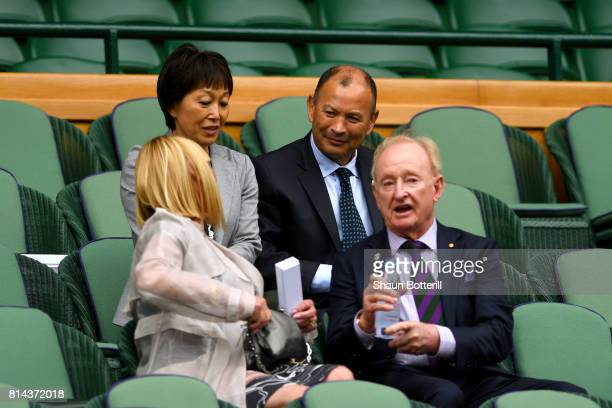 England rugby head coach Eddie Jones and Rod Laver look on from the centre court royal box on day eleven of the Wimbledon Lawn Tennis Championships...