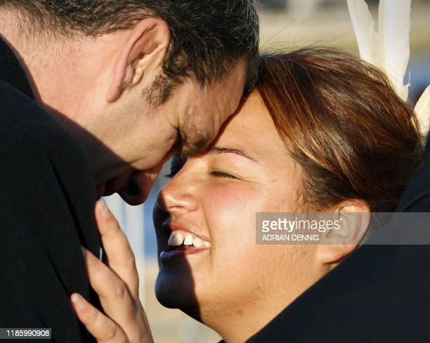 England Rugby Head Coach Martin Johnson performs a hongi with a Maori woman during the arrival of rugby players and officials at the giant New...