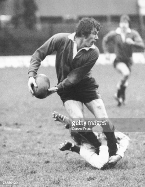 England rugby international Tony Bond about to get a pass away as he is tackled during a team trial at Twickenham London 1st January 1977