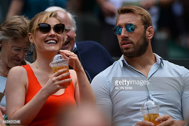 England rugby player Chris Robshaw sits with singer Camilla Kerslake in the royal box as they prepare to watch US player Serena Williams play...