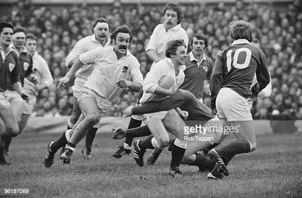England rugby player John Carleton is tackled during an international at Twickenham London 19th January 1980 In support are England players Roger...