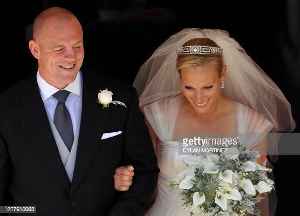 England rugby player Mike Tindall and his new bride Britain's Zara Phillips, granddaughter of Queen Elizabeth II, leave after their wedding ceremony...