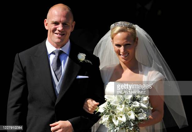 England rugby player Mike Tindall and his new bride Britain's Zara Phillips, granddaughter of Queen Elizabeth II, pose for pictures after their...