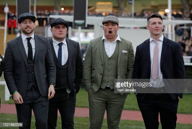 England rugby players lr Elliot Daly Jamie George Ellis Genge and Tom Curry during day one of the Cheltenham National Hunt Racing Festival at...