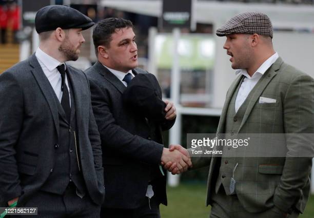 England rugby players lr Elliot Daly Jamie George Ellis Genge during day one of the Cheltenham National Hunt Racing Festival at Cheltenham Racecourse...