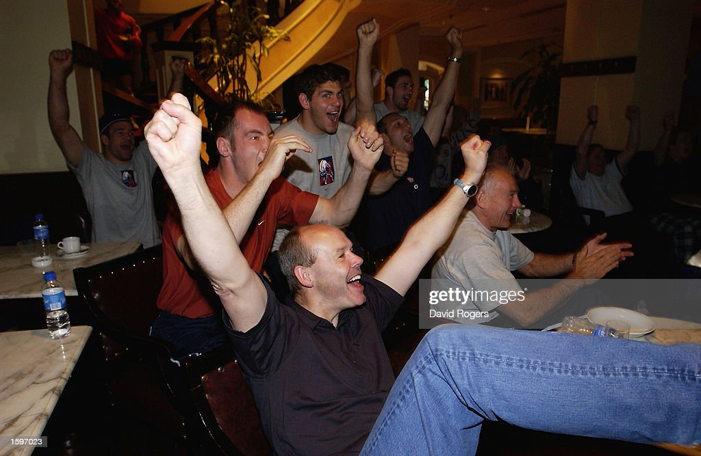 England Rugby Union coach Clive Woodward leads the celebrations as the team watch the England and Denmark FIFA World Cup Finals 2002 Second Round match : News Photo