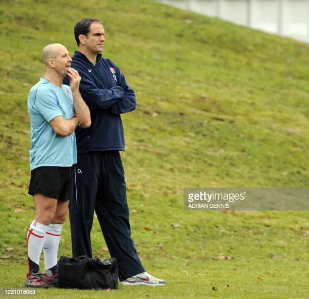 England rugby union coach Martin Johnson and team physio Phil Pask look on during a training session at Pennyhill Park Hotel in Bagshot, west of...