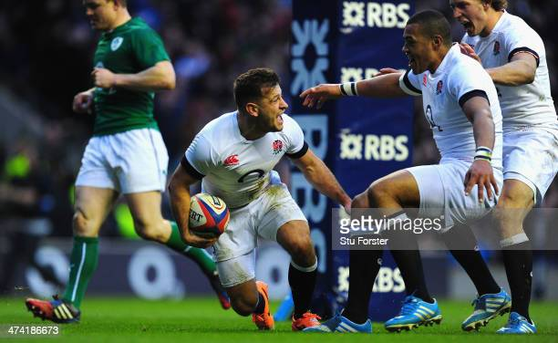 England scrum half Danny Care celebrates after scoring the first England try with Billy Twelvetrees and Luther Burrell during the RBS Six Nations...