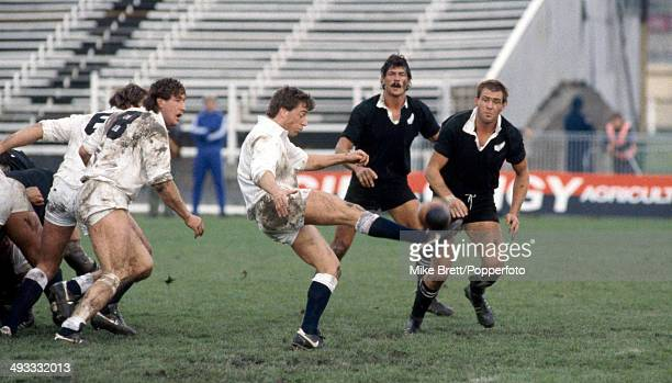 England scrumhalf Nigel Melville kicks watched by Murray Mexted of New Zealand with teammate Mark Shaw during the First Test match between New...