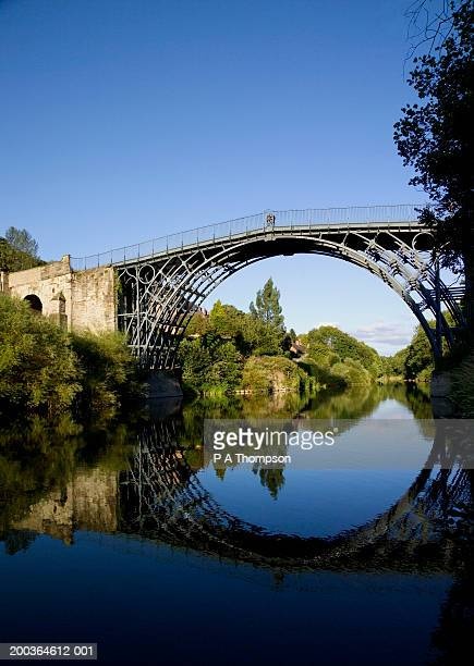 england, shropshire, ironbridge and reflection in river severn - ironbridge shropshire stock pictures, royalty-free photos & images