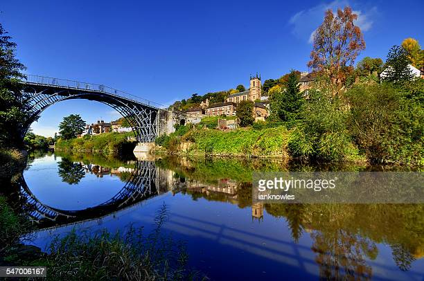 UK, England, Shropshire, Telford, Symmetrical view of Ironbridge and hill reflecting in water