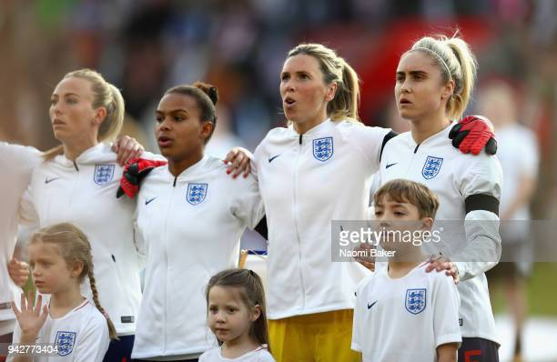 England sing the national anthem prior to the Women's World Cup Qualifier between England and Wales at St Mary's Stadium on April 6 2018 in...