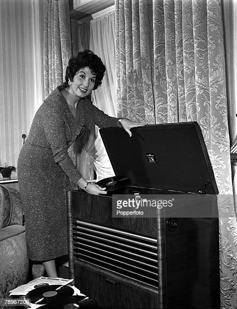 England Singer Alma Cogan is pictured listening to records in her flat
