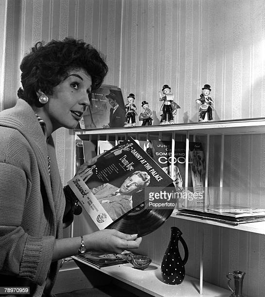 England Singer Alma Cogan is pictured with a record by Danny Kaye