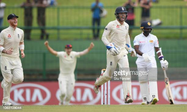 England slip Ben Stokes captain Joe Root and wicketkeeper Ben Foakes celebrate after Jack Leach had taken the final Sri Lanka wicket of Malinda...