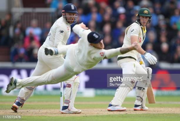 England slip fielder Ben Stokes dives in vain for an edge from Australia batsman Marnus Labuschagne as Jonny Bairstow looks on during day one of the...