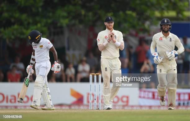 England slip fielder Ben Stokes takes the catch to dismiss Sri Lanka batsman Akila Dananjaya during Day Four of the First Test match between Sri...