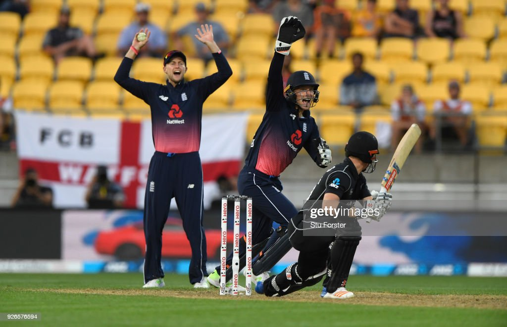 England slip fielder Joe Root (l) and keeper Jos Buttler appeal with success for the wicket of Henry Nicholls during the 3rd ODI between New Zealand and England at Westpac stadium on March 3, 2018 in Wellington, New Zealand.