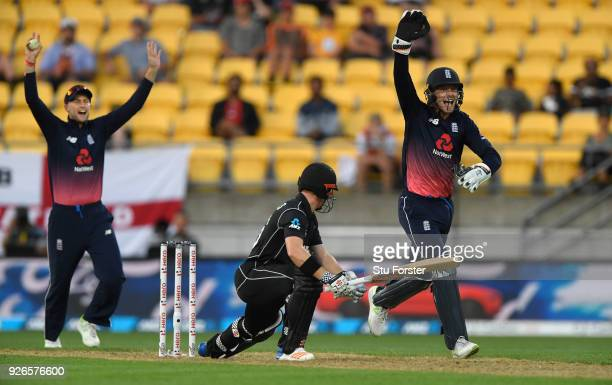 England slip fielder Joe Root and keeper Jos Buttler appeal with success for the wicket of Henry Nicholls during the 3rd ODI between New Zealand and...
