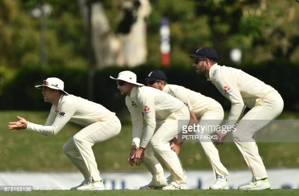 TOPSHOT England slip fielders watch the ball on the third day of a fourday Ashes tour match against Cricket Australia XI at the Tony Ireland Stadium...