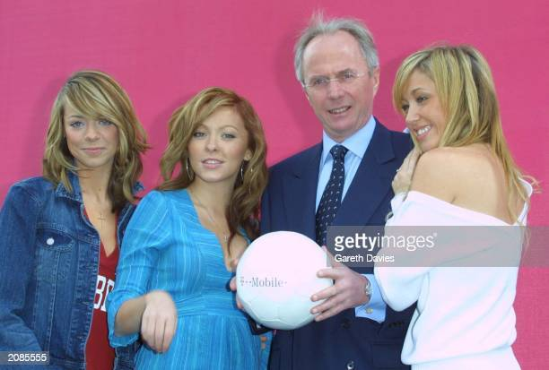 England soccer coach SvenGoran Eriksson poses with Atomic Kitten's Liz McClarnon Natasha Hamilton and Jenny Frost during the launch of TMobile...